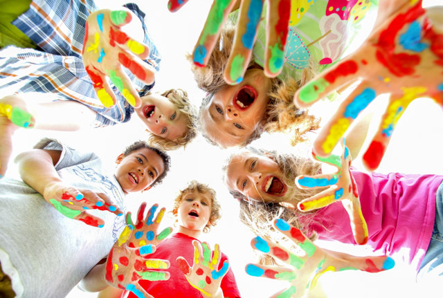 The picture of smiling kids with colourful hands. SESLHD PHU provides advice and support to early childhood facilities and childcare centres to help limit the spread of infections and respond to outbreaks
