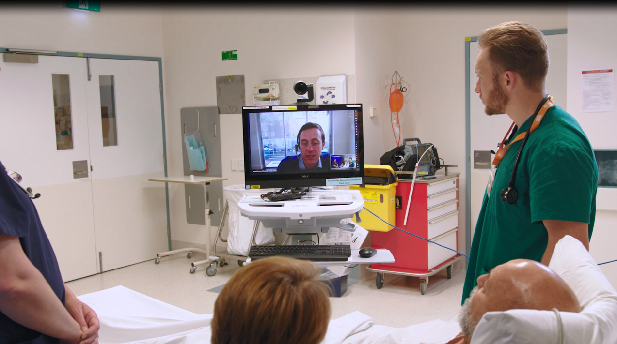 Patient and staff receiving care via videoconference